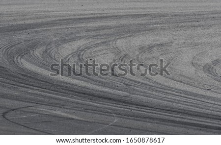 Asphalt race track detail with tire mark. Motorsports racing circuit close up. #1650878617