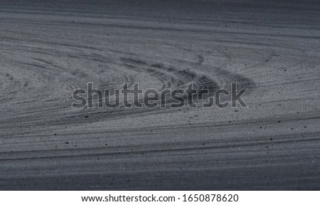 Asphalt race track detail with tire mark. Motorsports racing circuit close up. #1650878620