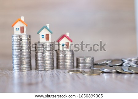 House on the coin ladder Real estate concepts, mortgages, investments, save money or invest for future houses, house designs and coins. #1650899305