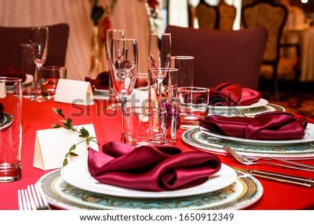 The table in the restaurant is set for dinner. Romantic dinner. love dinner. #1650912349