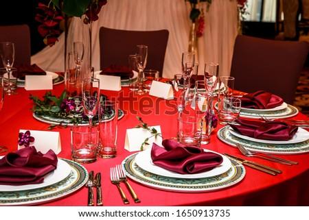 The table in the restaurant is set for dinner. Romantic dinner. love dinner. #1650913735