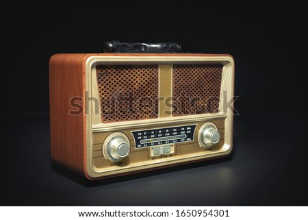Retro old radio receiver on black background #1650954301
