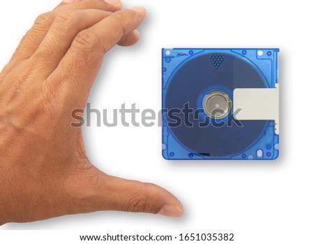 Isolate Used blue mini disc MD and hand going to pick up. Put on white background for data and music recording, Concept music players,  Concept re writable data sheets  with clipping parts
