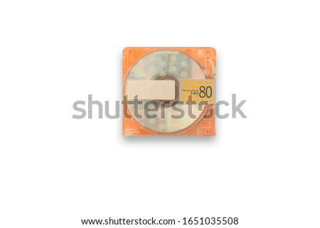 Isolate Used orange mini disc MD. scratches on  skin. Put on white background for data and music recording, Concept music players, capacity music discs, Concept re writable data sheets  clipping parts