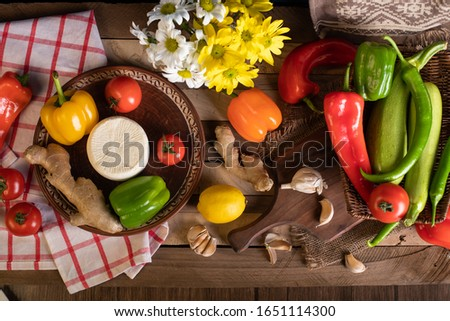Vegetables mix on a wooden table #1651114300