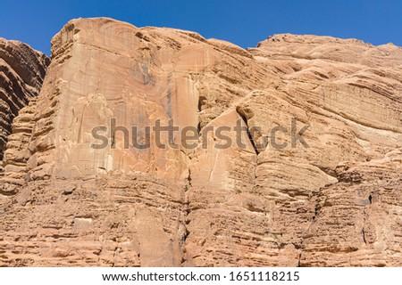 Majestic vertical red cliffs in the Wadi Rum Desert. Beautiful mountain landscapes of nature Jordan in Wadi Rum Desert.  #1651118215