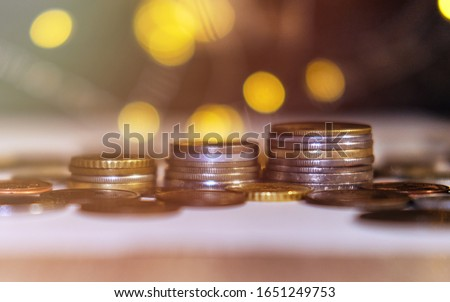 Coins stacked in stacks on a colored background with a side #1651249753