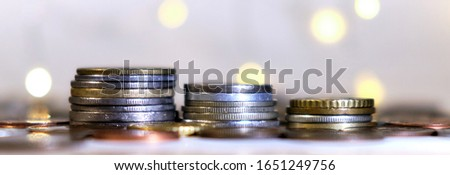 Coins stacked in stacks on a colored background with a side #1651249756