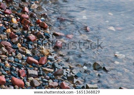 the rocky shoreline of the bay #1651368829