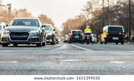 blurred highway traffic  pic with  cars waiting for light in bright  day in Lisbon Portugal. date 20 February  2020