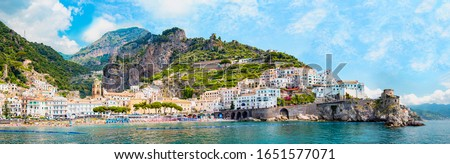 Panoramic view, aerial skyline of small haven of Amalfi village with tiny beach and colorful houses, located on rock, Amalfi coast, Salerno, Campania, Italy Royalty-Free Stock Photo #1651577071