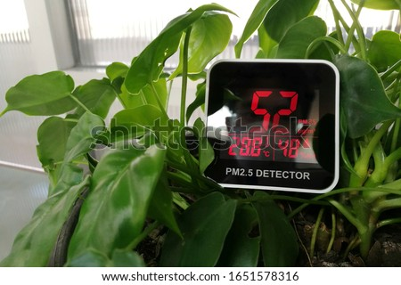 code red, Harmful PM 2.5 invisible harmful dust founded by large amount in an indoor environment. bad environment poor air quality even with plant. air too polluted environment beyond natural order. #1651578316