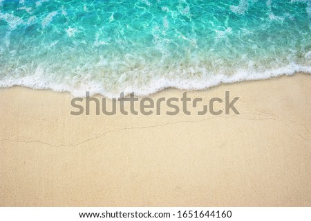 Beautiful Soft Turquoise ocean wave on Fine sandy beach Summer Background Concept #1651644160
