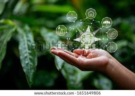 Technology, hand holding with environment Icons over the Network connection on green background. #1651649806