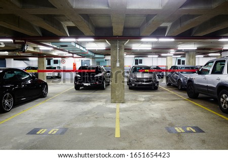 Photograph of an interior of a car park in the basement of a commercial office building in Sydney NSW Australia #1651654423