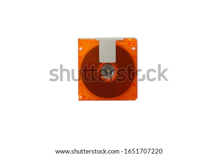 Isolate blur and noise orange mini disc MD on white background for data and music recording, Concept music players, high-capacity music discs, re-writable data sheets  with clipping parts