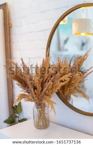 Home decore interior design. Dry flower straws in a vase #1651737136