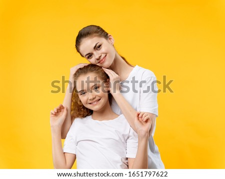 funny mom and daughter in white t-shirts hugging t-shirts smile joy #1651797622