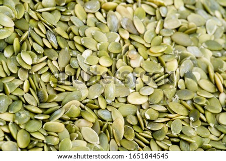 Texture background, pattern. Dried fruits. the sweet and fleshy product of a tree or other plant that contains seed and can be eaten as food.  desiccated, exsiccated, roughage #1651844545