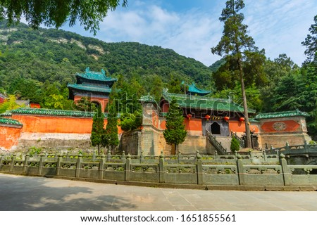 Ancient Purple Cloud Palace or Zixiao Palace is one of the best preserved palaces on Wudang Mountain, Hubei province, China (text: Zixiao Palace or Purple Cloud Palace) #1651855561