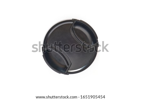 Black photo lens cap isolated on white background - top down view. #1651905454