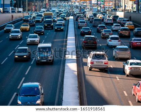 Moscow, Russia - February 8, 2020: Heavy traffic on the third traffic ring on a sunny Saturday afternoon. #1651918561