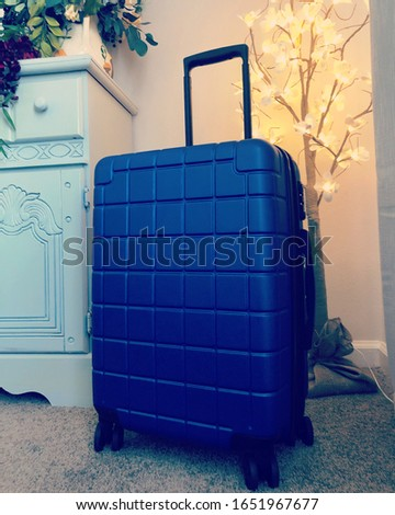 Blue suitcase ready for travel #1651967677