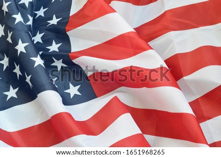 United States of America waving flag with many folds
