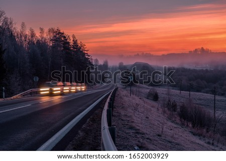 Dramatic sunrise by the road. 5 pictures merged into one to get this motion blur effect on a car