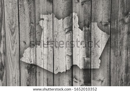 Detailed and colorful image of map of Amazonas on weathered wood #1652010352