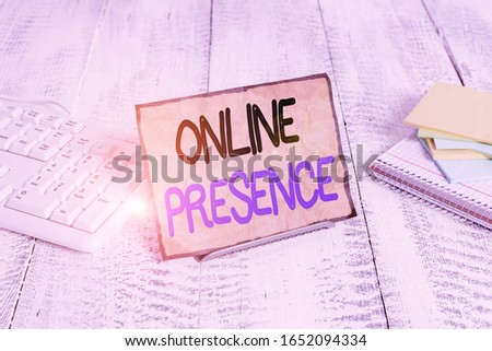 Text sign showing Online Presence. Conceptual photo existence of an individual can be found via an online search Notepaper stand on buffer wire in between computer keyboard and math sheets.