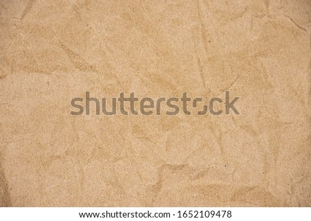 Close up of Recycled brown wrinkle paper texture for background Royalty-Free Stock Photo #1652109478
