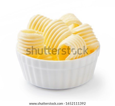 Butter curls or butter rolls in white bowl isolated on white background. #1652111392