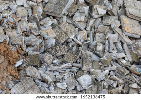 Cement debris and sidewalk tiles in the city. Public works (sequence of images) #1652136475