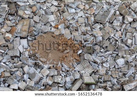 Close-up of cement debris and tile of a sidewalk in the city. Public works (sequence of images) #1652136478