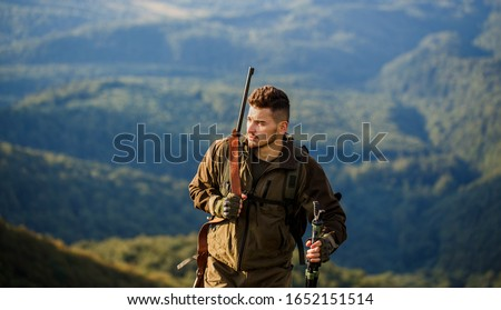 Hunt hunting rifle. Hunter man. Hunting period. Male with a gun. Hunter with hunting gun and hunting form to hunt. Shooter sighting in the target. The man is on the hunt. #1652151514