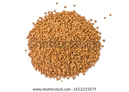 Pile of buckwheat isolated on white background. Top view. Buckwheat. Stockpiling. Buckwheat grains. Grain culture. Гречка. Pandemic #1652221879