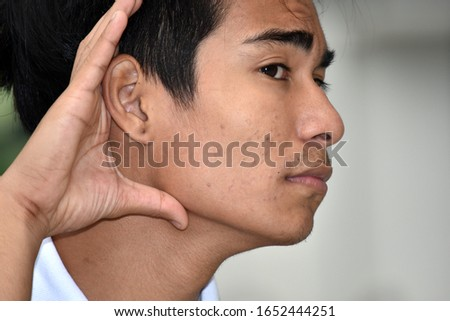 An Adult  Asian Male Hearing #1652444251