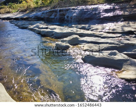 """Miraculous fossils left behind by an explosion of an estimated 1.8 million years ago. A river surrounded by fossils. The name of the miracle river is """"ASAKAWA"""". Valuable fossils are metasequoia trees. #1652486443"""