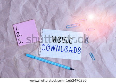 Word writing text Movie Downloads. Business concept for transfers entire film for local storage and later use Papercraft craft paper desk square spiral notebook office study supplies. #1652490250