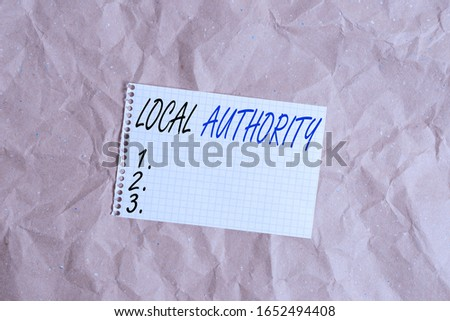 Text sign showing Local Authority. Conceptual photo the group of showing who govern an area especially a city Papercraft craft paper desk square spiral notebook office study supplies. #1652494408