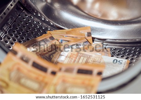 Money in washing machine, closeup view. Money washing. Money laundering Royalty-Free Stock Photo #1652531125