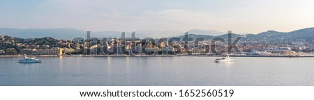 Panoramic view, aerial skyline of city Cannes, Mediterranean Sea with yachts, coastline, port morning at dawn in Cannes, Cote d'Azur, France Royalty-Free Stock Photo #1652560519