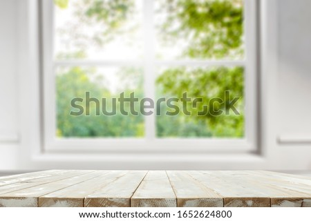 Table background of free space and spring window background.  Royalty-Free Stock Photo #1652624800