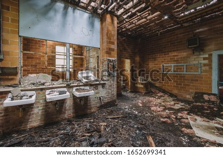 Marianna, Florida/USA - April 21, 2012: Interior of one of the dormitories at the infamous Arthur G. Dozier School for Boys in Marianna, Florida #1652699341