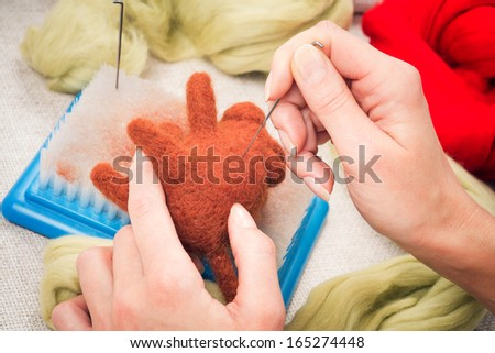 Manufacturing process from wool soft toys. Felting #165274448