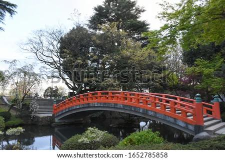 TOYAMA CASTLE RUIN PARK, TOYAMA, JAPAN :22/4/2017: Picture of beautiful red bridge Toyama castle ruin park in the evening, toyama, Japan