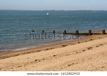 A breakwater, a barrier built out into the sea to protect a coast or harbour from the force of waves, jutting into the North Sea off the coast of Southend-on-Sea. #1652802910