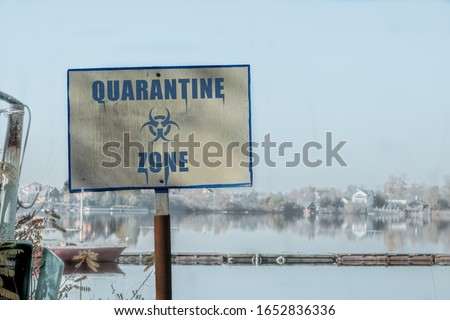 """Quarantine zone sign. Sign with the inscription """"Quarantine zone"""" against the infected area #1652836336"""