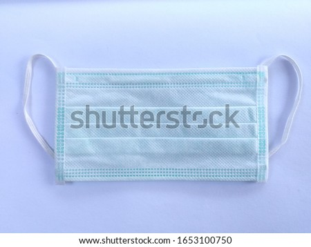 Green mask on a white background #1653100750